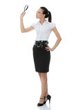 Business woman holding magnifying glass Stock Photography