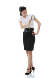 Business woman holding magnifying glass Stock Images