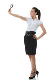 Business woman holding magnifying glass Royalty Free Stock Photography