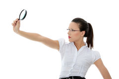 Business woman holding magnifying glass Royalty Free Stock Images
