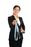 Business woman holding a measuring tape Stock Photos