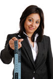 Business woman holding a measuring tape Stock Image