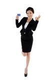 Business woman holding membership card with ok sign isolated on white background Stock Photography