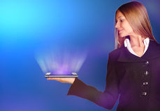 Business woman holding a mobile phone with rays. Royalty Free Stock Photo