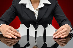 Business woman holding a model house Royalty Free Stock Images