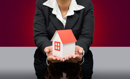 Business woman holding a model house Stock Image