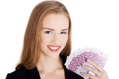 Business woman holding money- euro currency. Young beautiful business woman holding money- euro currency. Isolated on white Royalty Free Stock Photography