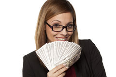 Business woman holding money Stock Photo
