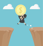 Business Woman holding money jumping over the cliff Royalty Free Stock Image