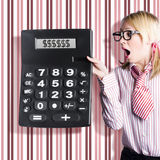 Business woman holding money savings calculator Royalty Free Stock Image