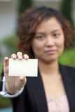 Business woman holding a name card Royalty Free Stock Photos