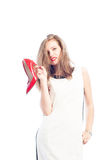 Business woman holding new red shoes Royalty Free Stock Images