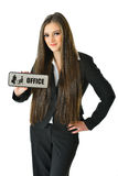 Business Woman Holding Office Sign. Business woman holding a gray office sign Stock Images
