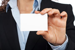 Business woman holding one blank card Stock Photo