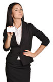 Business woman holding in one hand a blank white Royalty Free Stock Photo