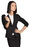 Business woman holding in one hand a blank white Stock Photo