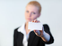 Business woman holding out a business card Stock Image