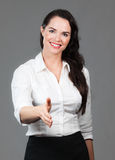 Business woman holding out hand Stock Photo