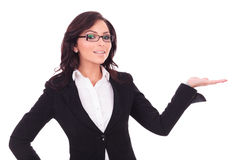 Business woman holding palm out Stock Photo
