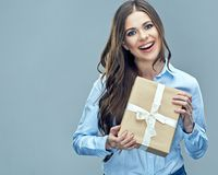 Business woman holding paper gift box. Toothy smiling face. Isolated background Stock Image