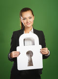 Business woman holding paper lock on green background Stock Image