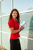Business woman holding papers and writing Stock Photography