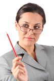 Business woman holding pencil Royalty Free Stock Image