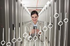 Business woman holding a phone and graphics in server room Stock Photos