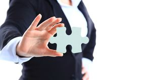 Business woman holding a piece of puzzle Stock Photography