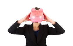 Business woman holding a piggy bank in front of her face Stock Photography