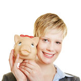 Business woman holding piggy bank Stock Photos