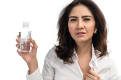 Business woman holding plastic bottle of water. Woman holding plastic bottle of water royalty free stock photos