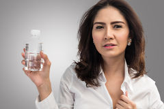 Business woman holding plastic bottle of water. On gray background with clipping path stock photos
