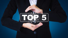 Business woman holding posts in TOP 5. Stock Image