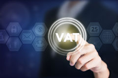 Business woman holding posts in VAT. Can be used in advertising Stock Photography