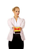 Business woman holding present box Stock Photo