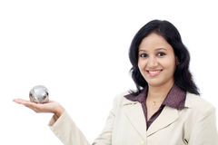 Business woman holding puzzle globe Stock Photo