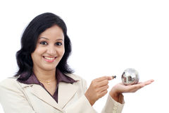 Business woman holding puzzle globe Royalty Free Stock Images