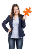 Business woman holding a puzzle piece Royalty Free Stock Image