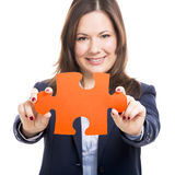 Business woman holding a puzzle piece Royalty Free Stock Photo