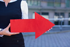 Business woman holding red arrow Stock Image