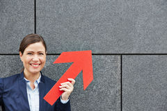 Business woman holding red arrow up royalty free stock photo