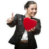 Business woman holding red heart Stock Photography