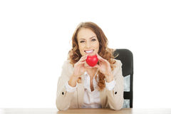 Business woman holding red heart. Royalty Free Stock Photo