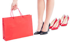 Business woman holding a red shopping paper bag Stock Photos