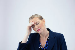Business Woman Holding Right Hand to Forehead Eyes Closed stock image