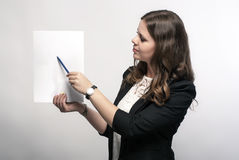 Business woman is holding a sheet of paper. Stock Photo