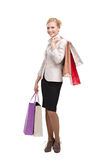 Business woman holding shopping bags Stock Images