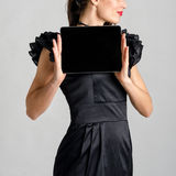 Business woman holding and shows touch screen tablet pc with blank screen Royalty Free Stock Images