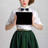 Business woman holding and shows touch screen tablet pc with blank screen Royalty Free Stock Photos